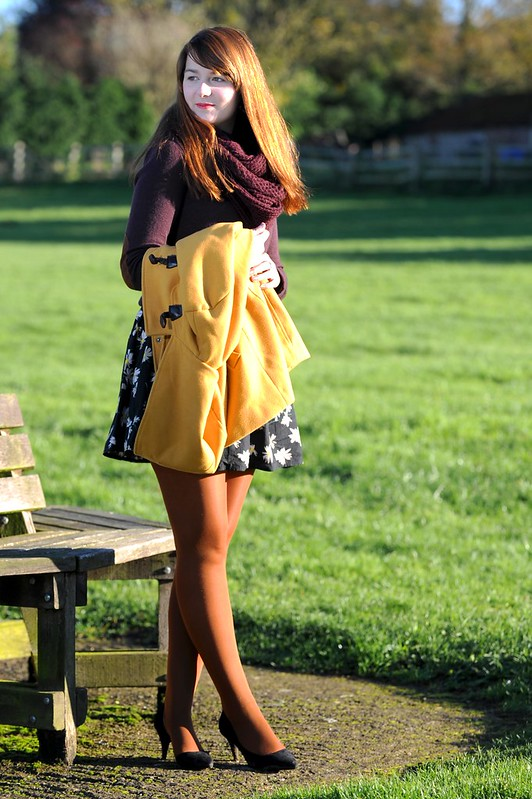 Mustard coat, floral dress, heels