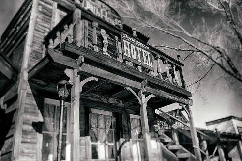 california wood old windows blackandwhite bw usa west tree window set vintage hotel blackwhite nikon balcony structure porch worn d200 movieset hdr bathhouse sanbernardino oldwest pioneertown hbmike2000 manestreethotel