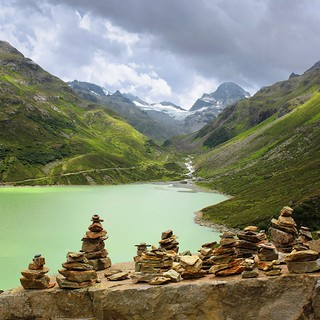 Terrace of man-made pile of stones overlooking the glacier meltwater