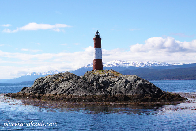 ushuaia lighthouse with snow capped mountain