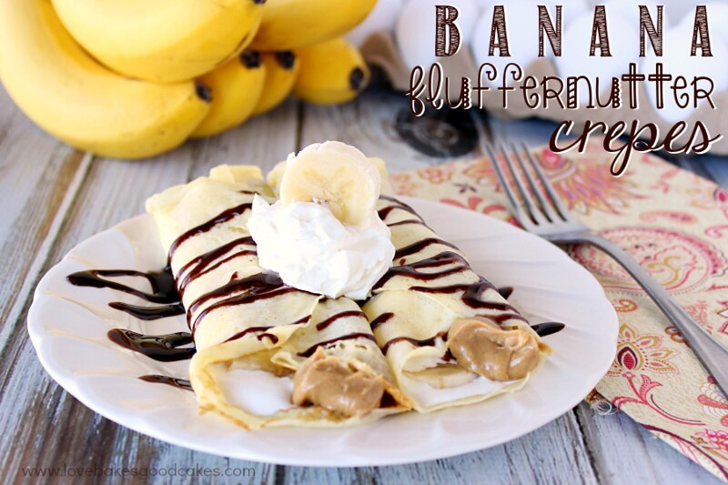 Banana Fluffernutter Crepes on a white plate with a fork.