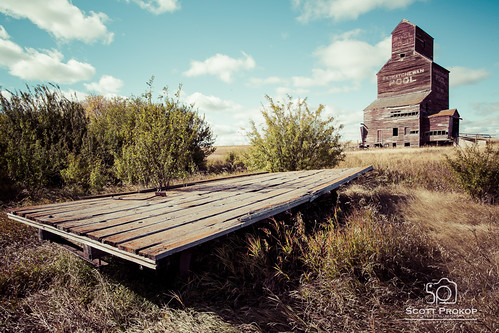 wood old canada building abandoned wheel rural vintage wagon landscape farm farming elevator transport grain structure storage silo harris trailer prairie hay saskatchewan cart agriculture prairies bents
