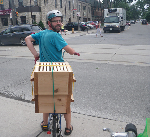 Bringing new hive boxes on the back of my bike