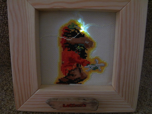LeChuck's pin lit up as he goes for the voodoo doll of Guybrush