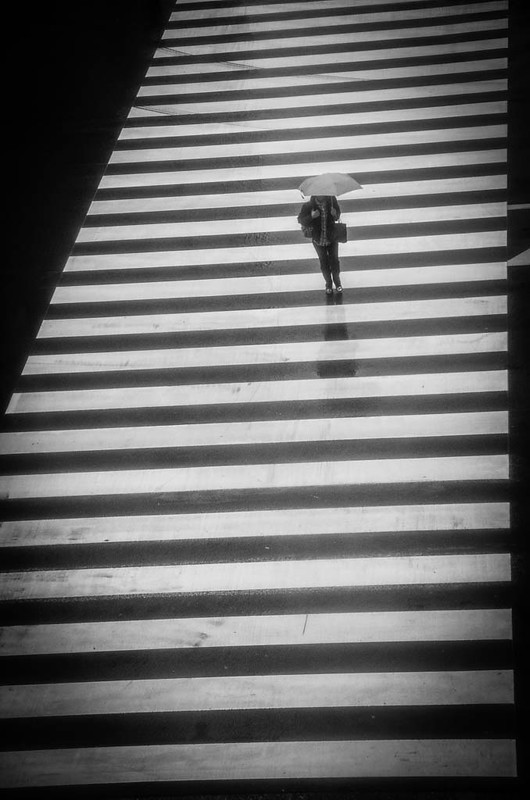 A lone figure crossing the road in Shinjuku