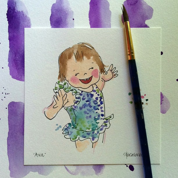 mini watercolor portraits by an open sketchbook