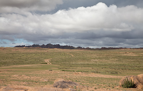 road travel storm clouds landscape rocks desert adventure mongolia gobi province dundgovi