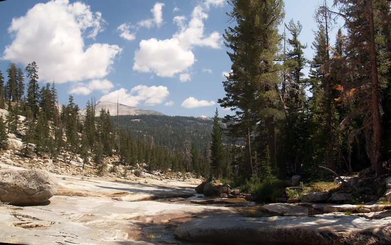Spiller Creek as it cascades over bare granite on the way to Virginia Canyon, Sheep Peak in the distance