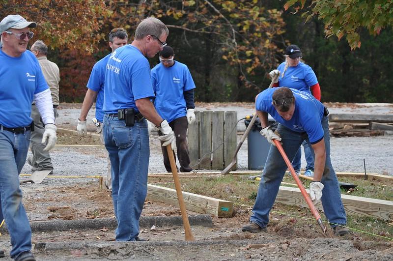 Dominion volunteers working on parking lot islands