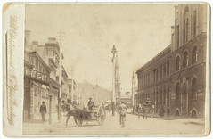 With Christmas and New Year Greetings (view west down Paterson Street, Launceston with horses and carts.)