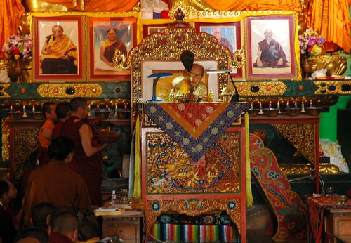 His Holiness Dagchen Sakya blessing the 5 Dhyani crowns for the empowerment, on traditional Tibetan Buddhist lama throne, shrine with photos of senior Sakya master, masters of ceremonies, Sakya Lamdre, Hevajra, Tharlam Monastery, Boudha, Kathmandu, Nepal by Wonderlane