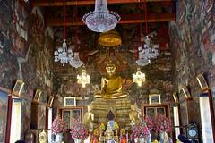 Buddha image in the ordination hall of Wat Arun, Bangkok, Thailand