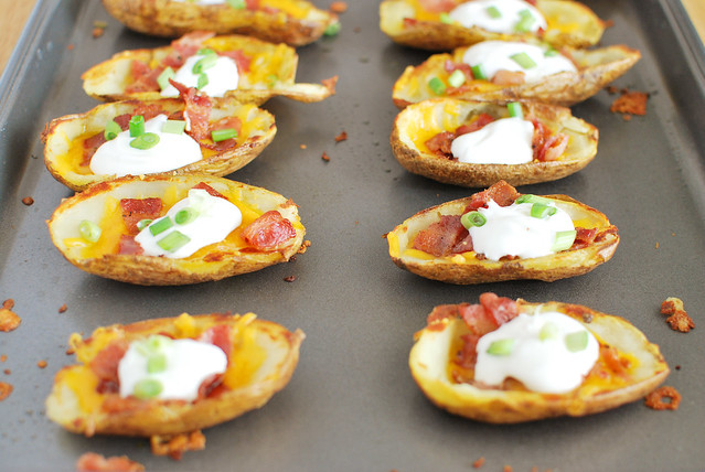 Potato Skins recipe! A classic! Filled with cheddar cheese, bacon, sour cream, and green onions! These are always a hit at football parties!
