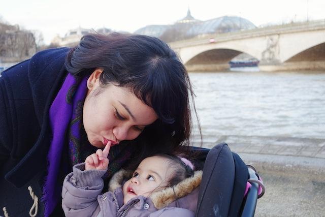 Paris walking baby along the Seine River