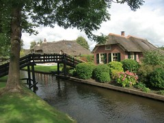 village(0.0), boathouse(0.0), estate(0.0), pond(0.0), moat(0.0), flower(1.0), garden(1.0), river(1.0), property(1.0), cottage(1.0), canal(1.0), rural area(1.0), waterway(1.0),
