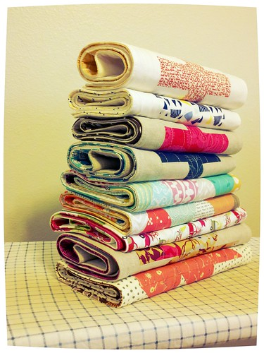 teetering tower of table runners
