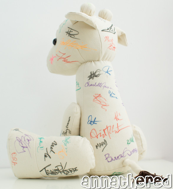 Giraffe plushies for the Child's Play Dinner Auction