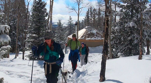 Johanne Tuttle, Jamie Tyson, Charity Parks and Chris Berry head out for cross-country skiing after checking into the Grizzly Ridge Yurt on the Ashley National Forest in Utah. The primitive camping site is open year-round but many people are drawn to it for its feeling of isolation and for the cross-country and snowshoeing trails. (U.S. Forest Service)