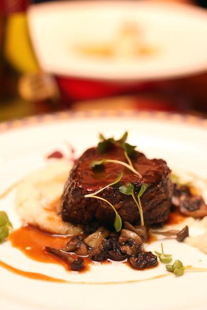 Beef Tenderloin stuffed with Foies Gras, Sautéed Mixed Mushrooms, Honey Glazed Jus