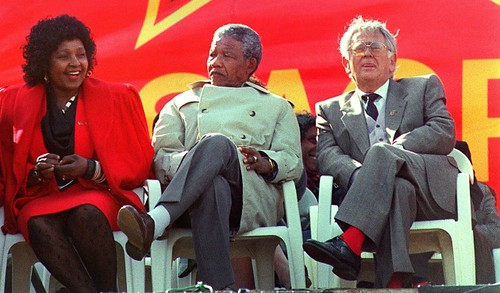 Winnie Mandela with Nelson Mandela and Joe Slovo at a rally of the South African Communist Party in 1990. Mandela was a member of the Central Executive Committee of the SACP. by Pan-African News Wire File Photos