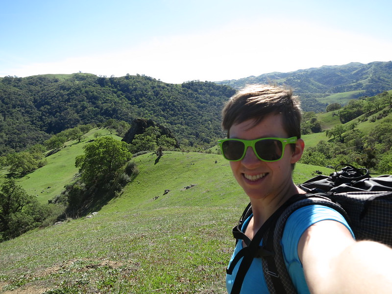 Alice enjoying the rolling green hills along the Ohlone Trail.