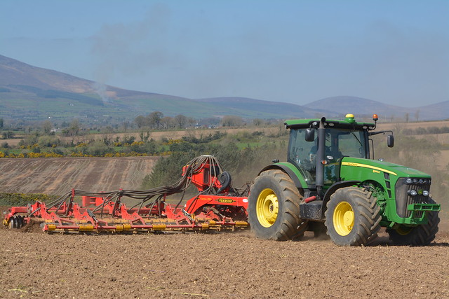 John Deere 8345R Tractor with a Vaderstad Carrier 1225 Cultivator