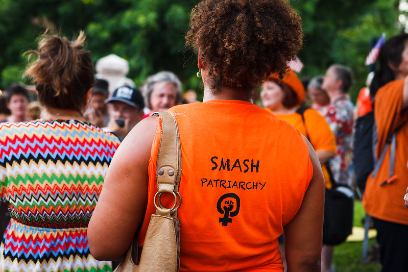 "a protester's shirt says ""smash patriarchy"""