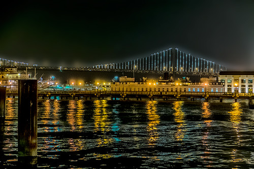 san francisco bay bridge and docks by joeeisner