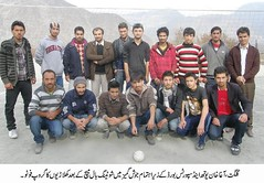 Players of a volleyball team pose in Gilgit for the press