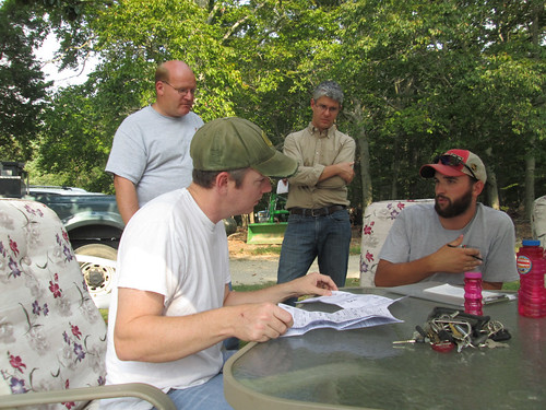 Staff members from the Alliance for the Chesapeake Bay and the Maryland Forest Service advise a forest landowner on options for how to  participate in a water quality trading system.