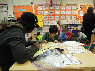 "A pre-k student at PS 261 gets help spelling the word ""puffin"""