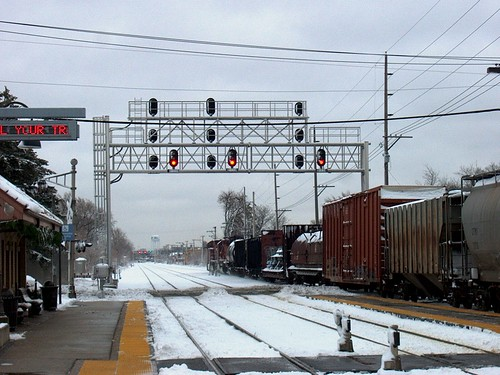 Eastbound Canadian Pacific freight train passing through the River Grove Illinois Metra commuter rail station.  December 1st, 2006. by Eddie from Chicago