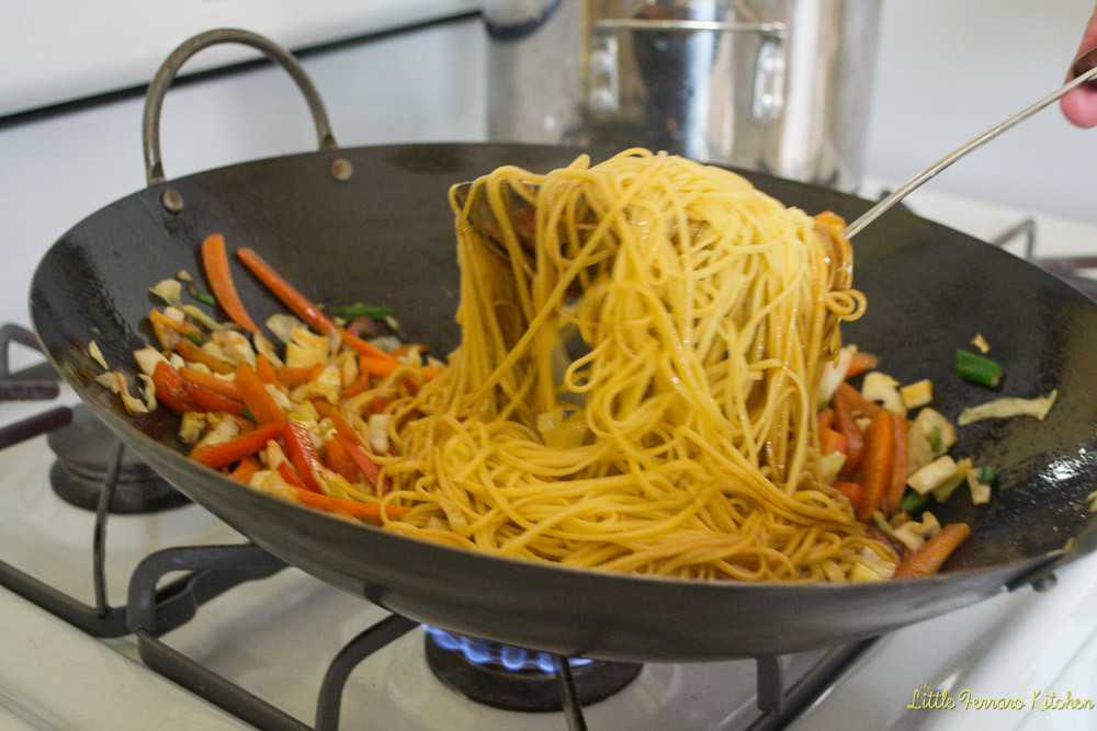 To make shrimp chow mein, add the vegetables, chow mein noodles and sauce to the hot wok after th shrimp is cooked.