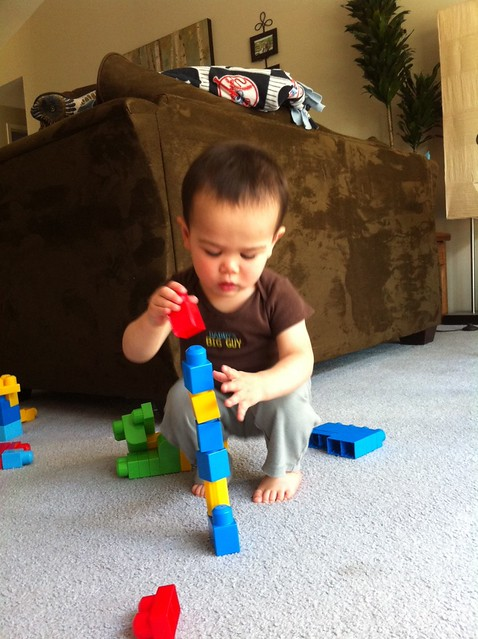 Stacking his mega blocks