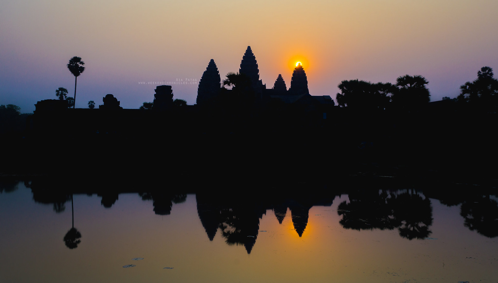 The sun rising behind Angkor Wat