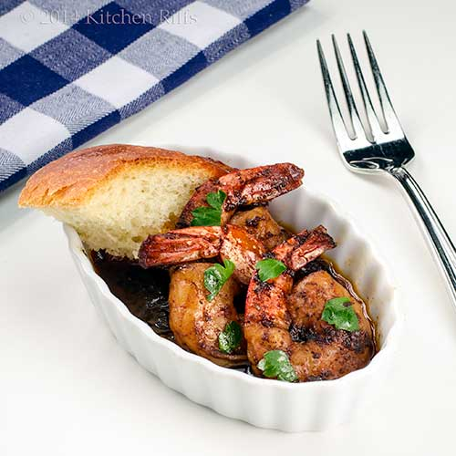New Orleans Barbecue Shrimp in oval ramekin with French Bread