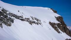 Czeka nas trudne podejście w rozmiękłym śniegu, stromym zboczem z nartami przypiętmi do placaków , na przełęcz Coli de Punta Fuora 3108m.