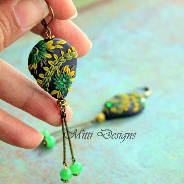 A customized pair made with shades of green, black and gold..  #madewithlove❤️ #handmade #madetoorder #Customized #Earrings #Polymerclay #handmadeearrings #MittiDesigns #RachanaSaurabh