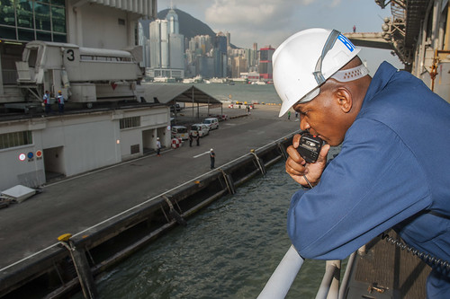 Senior Chief Boatswain's Mate Demetris Artis conducts mooring operations