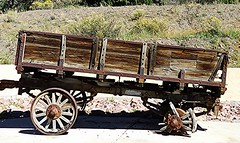 old wagon abandoned in a parking lot; New Mexico