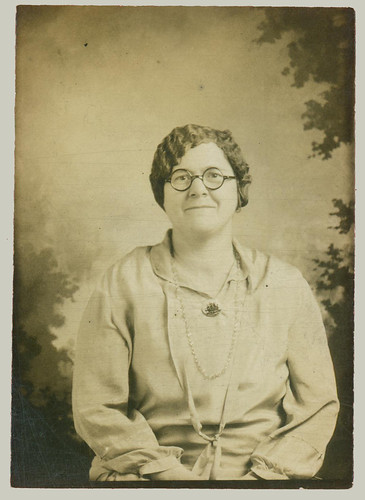 portrait with round glasses