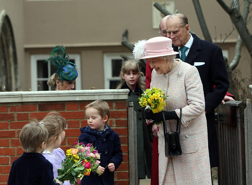 Queen Elizabeth II receieves flowers from local children on Easter Sunday (2013) © PA