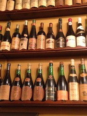 footwear(0.0), wine cellar(1.0), wood(1.0), wine rack(1.0), wine bottle(1.0), alcoholic beverage(1.0),