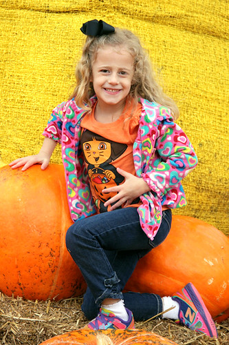 Aut-kneeling-by-pumpkin