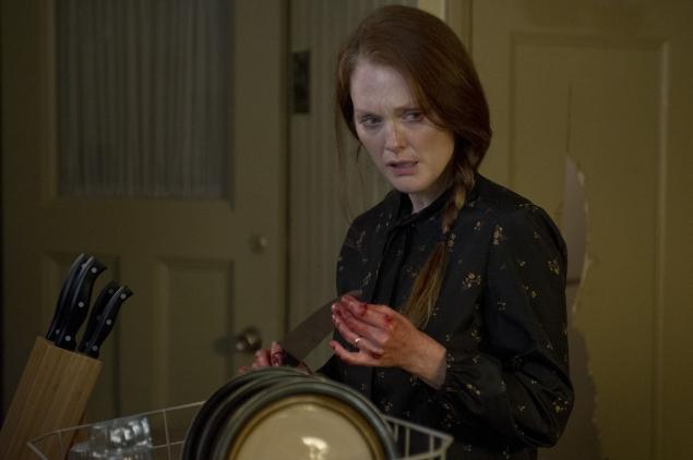 Julianne Moore, as Carrie's mom, with her hand covered in blood.
