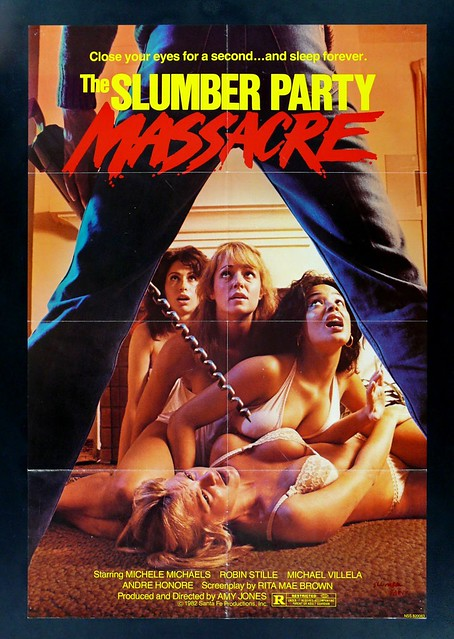 The movie poster has a giant drill poised above four scantily clad women