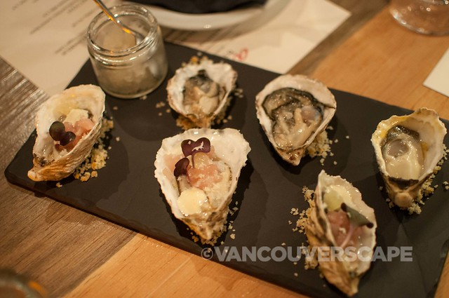 Kusshi oysters dressed with verjus granite, tuna tartar, and horseradish