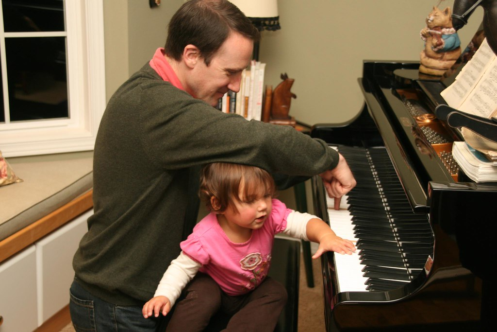 """In an attempt to pass the joy of music on to the next generation, I give my niece Sylvia a piano """"lesson"""" – though it's clear she's a natural, regardless of any help from me!"""