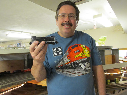 Fellow club member Eddie K, holding his Bachman H.O Scale Santa Fe Alco S 4 yard switcher. by Eddie from Chicago