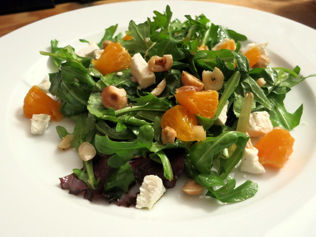 Arugula and mesclun salad, with ricotta salata, mandarin orange and hazelnuts